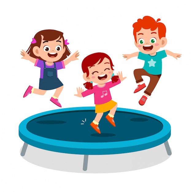 Il sorriso felice del bambino sveglio salta sul trampolino Vettore Premium