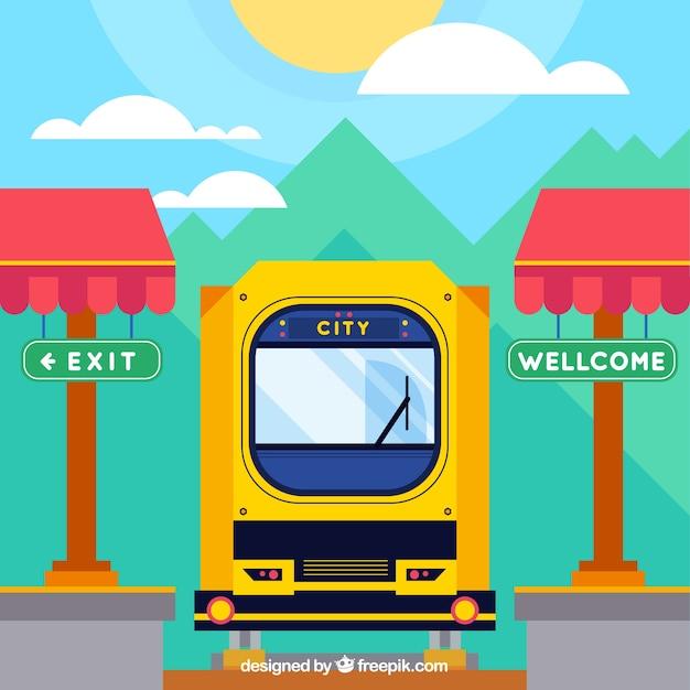 Il treno è arrivato alla città soleggiata Vettore gratuito