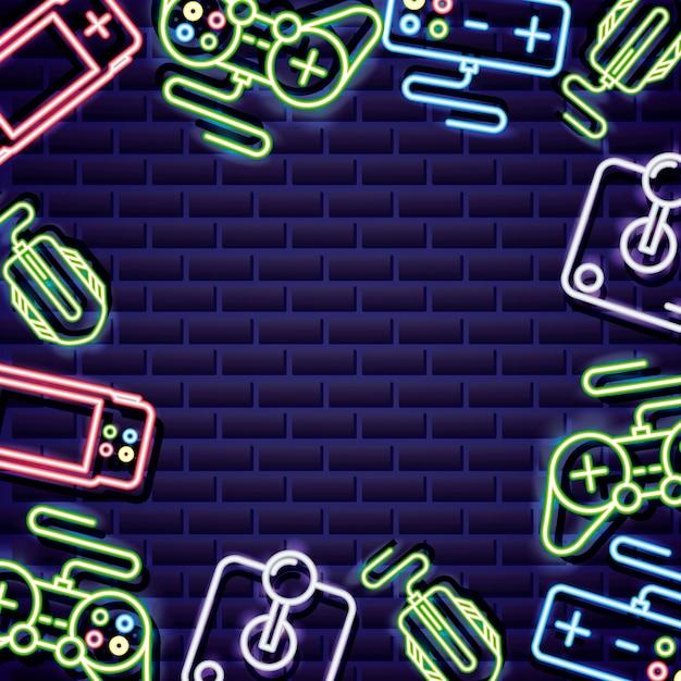 Il videogioco controlla la cornice in stile neon sul muro di mattoni Vettore gratuito