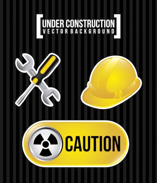 In costruzione su sfondo nero Vettore Premium