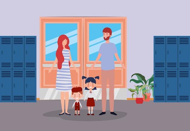 Insegnante coppia con bambini piccoli studenti nel corridoio della scuola Vettore gratuito