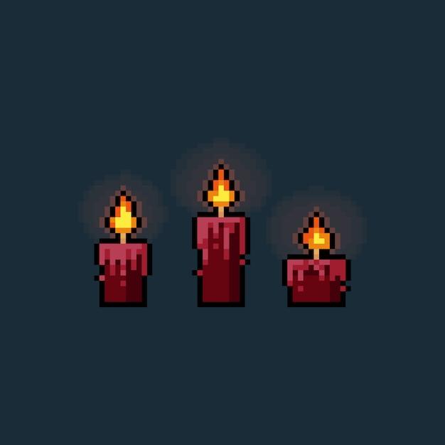 Insieme d'ardore rosso della candela del fumetto di arte del pixel. Vettore Premium