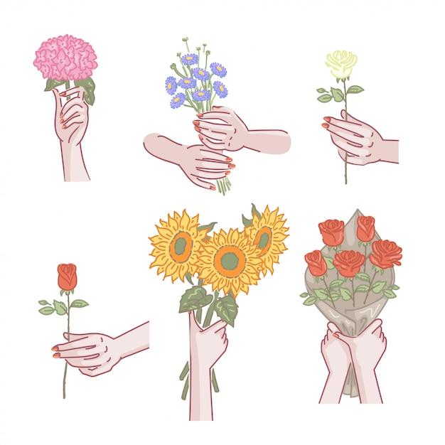 Insieme di fiori della holding della mano della donna Vettore Premium
