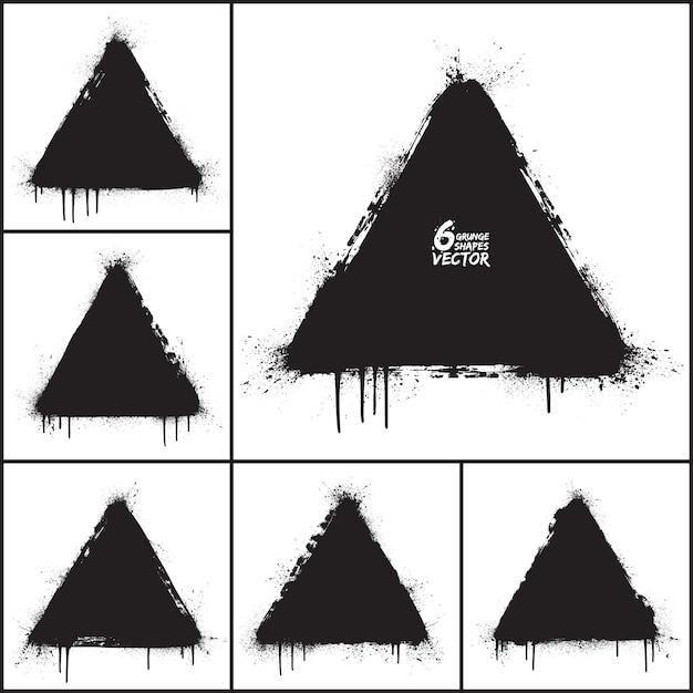 Insieme di vettore di forme di triangolo astratto di grunge Vettore Premium