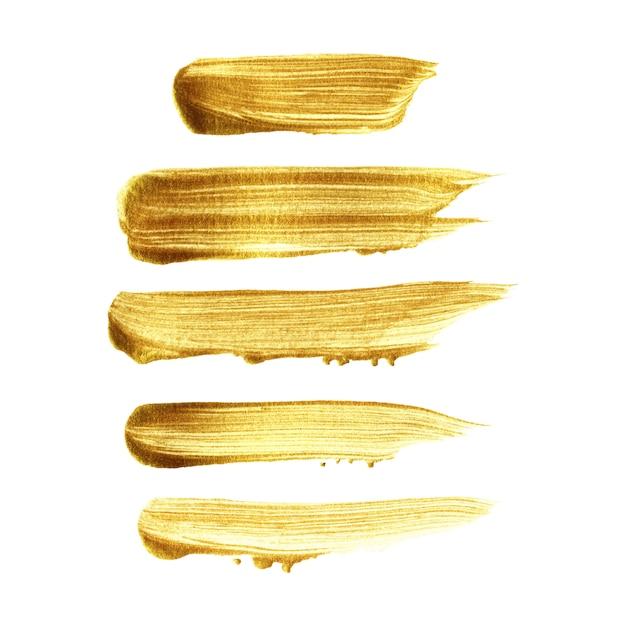 Insieme dipinto a mano del colpo della spazzola dell'oro isolato su fondo bianco Vettore Premium