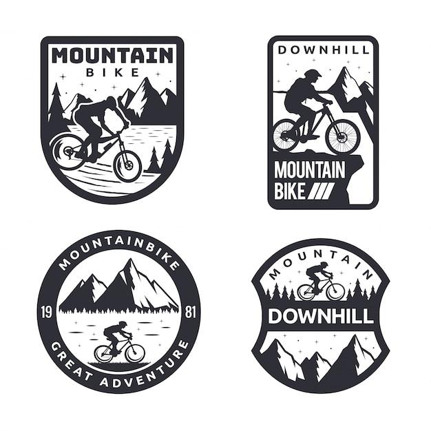 Insieme distintivo del distintivo di logo di mountain bike monotono d'annata Vettore Premium