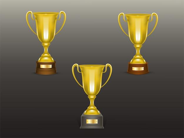Insieme realistico della tazza 3d, trofei dorati per il vincitore della concorrenza, campionato. Vettore gratuito
