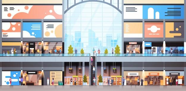 Interiore moderno del centro commerciale con molta gente grande vendita al dettaglio Vettore Premium