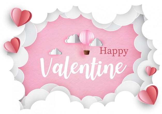 Iscrizione felice del biglietto di s. valentino con il pallone rosa nel buco del gigante delle nuvole e cuori rossi sul rosa. cartolina d'auguri di san valentino in stile e design del taglio della carta. Vettore Premium