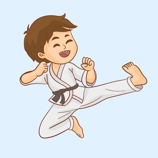 Karate di addestramento del giovane ragazzo Vettore Premium
