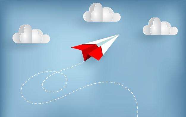 L'aereo di carta vola fino al cielo mentre vola sopra una nuvola. Vettore Premium