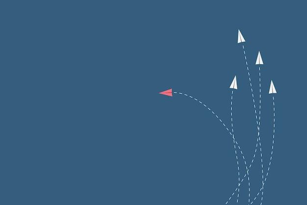 L'aereo rosso stile minimalista cambia direzione e quelli bianchi Vettore Premium