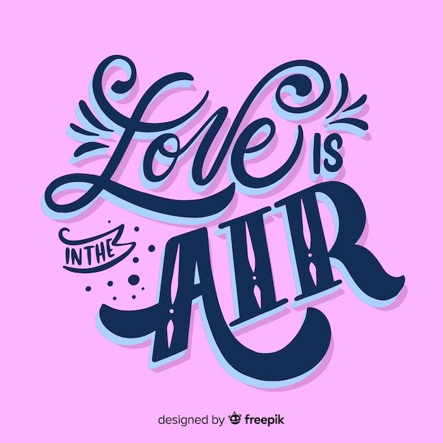 L'amore è nell'aria lettering Vettore gratuito