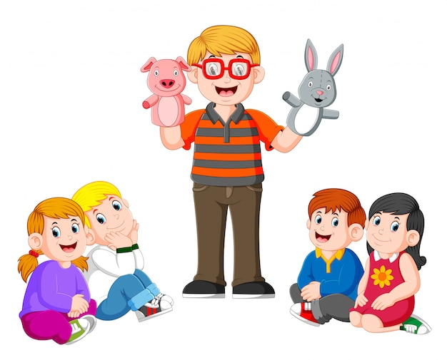L'insegnante sta facendo la storia raccontando con la bambola nelle mani Vettore Premium