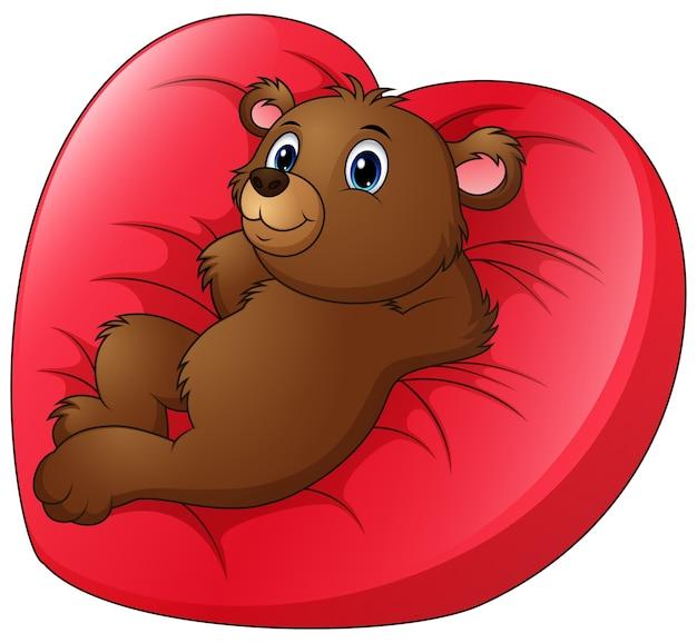 L\'orso del fumetto si rilassa sul letto a forma di cuore | Scaricare ...