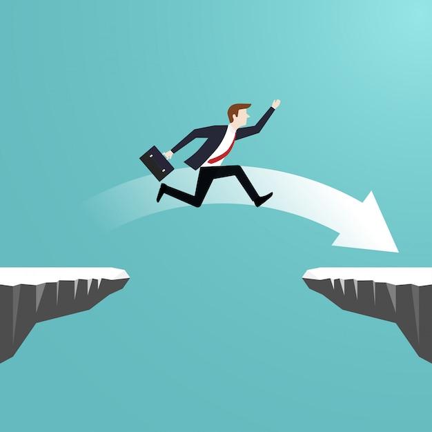 L'uomo d'affari che salta sopra la voragine della scogliera va al successo Vettore Premium