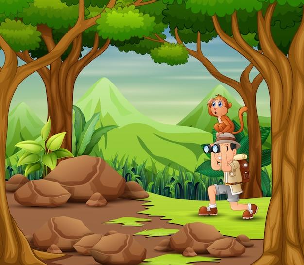L'uomo esploratore con scimmia nella foresta Vettore Premium
