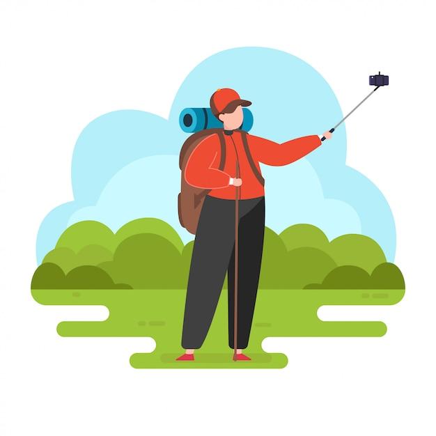 L'uomo prende il selfie, facendo un'escursione l'illustrazione Vettore Premium