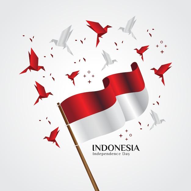 La bandiera rossa e bianca, la bandiera nazionale indonesiana che vola con uccelli origami Vettore Premium