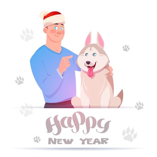 La carta del buon anno con l'uomo in cappello di santa che abbraccia il cane sveglio del husky sopra il piede stampa su fondo bianco Vettore Premium