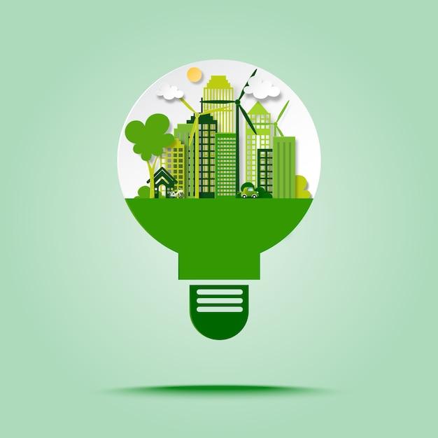 La città verde di eco con risparmia l'energia e ricicla il concetto nello stile di arte della carta della lampadina. Vettore Premium