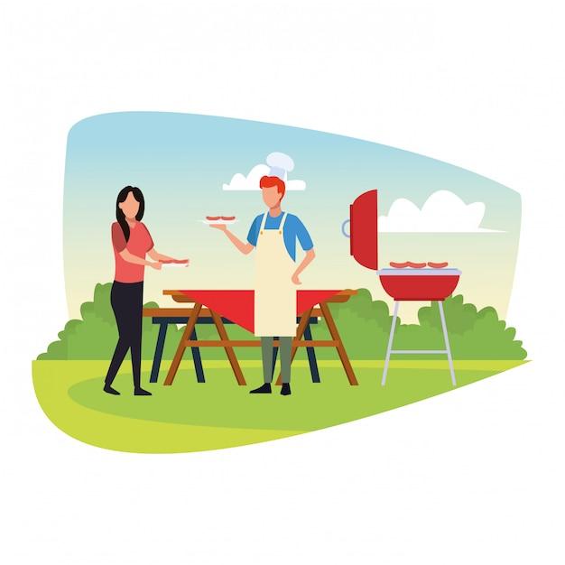 La donna e l'uomo dell'avatar che cucinano in un bbq grigliano Vettore Premium