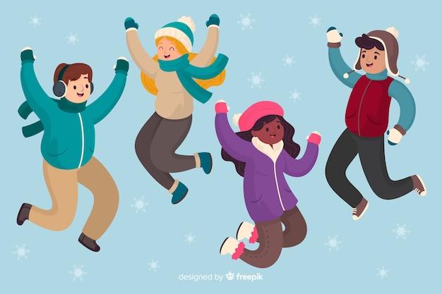 La gente che salta il fondo di stagione invernale Vettore gratuito