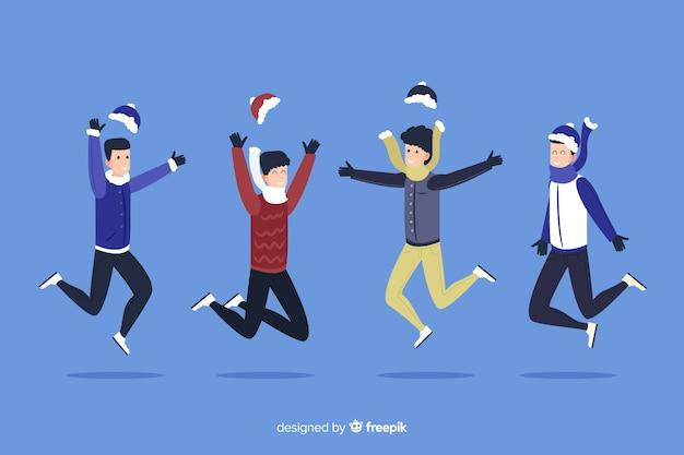 La gente con i cappelli che salta il fondo di stagione invernale Vettore gratuito