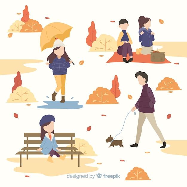 La gente nel parco in autunno Vettore gratuito