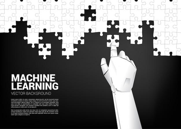 La mano del robot ha messo il puzzle. Vettore Premium