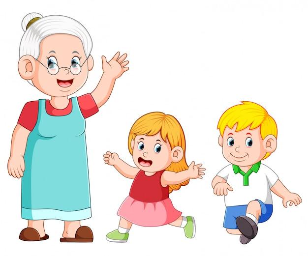 La nonna si sta prendendo cura e gioca con suo nipote Vettore Premium