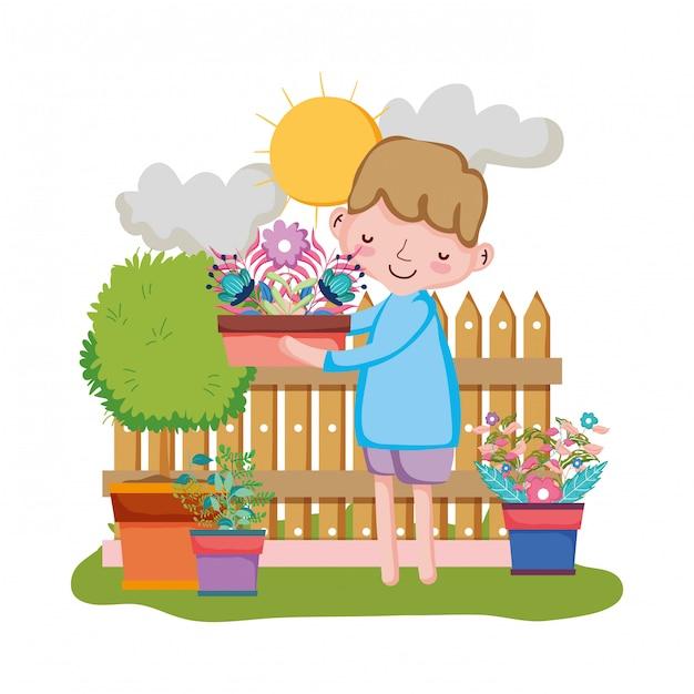 La pianta da appartamento di sollevamento del ragazzo con recinta il giardino Vettore Premium