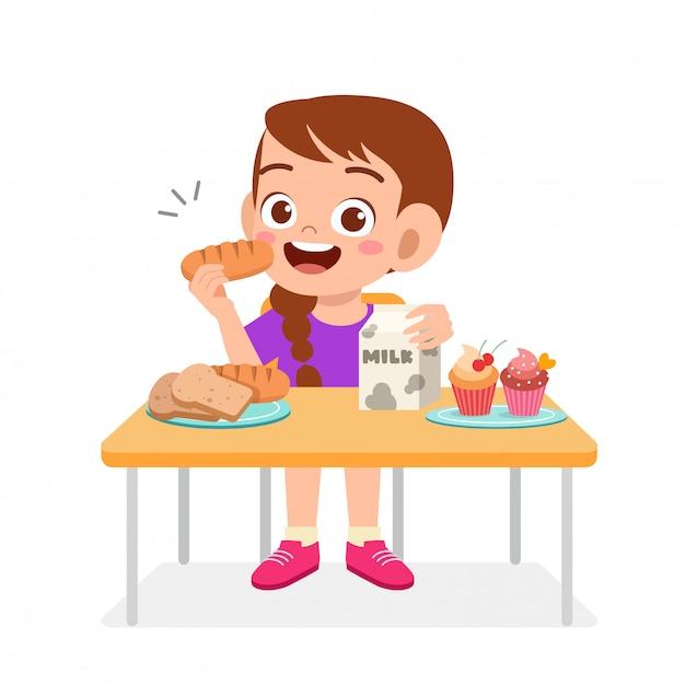 La ragazza sveglia felice del bambino mangia l'alimento sano Vettore Premium