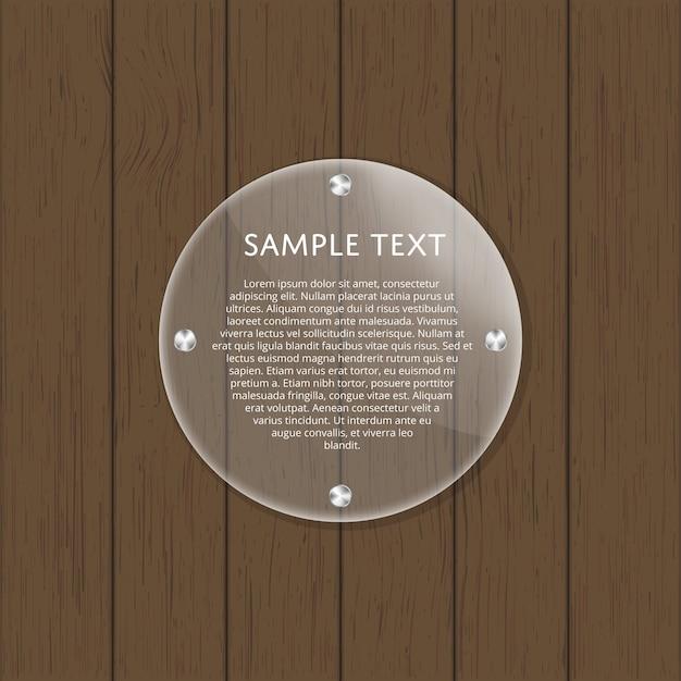 Lastra di vetro rotonda sulla tavola di legno Vettore Premium