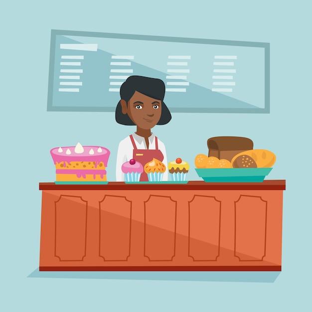 Lavoratore in piedi dietro il bancone del forno. Vettore Premium