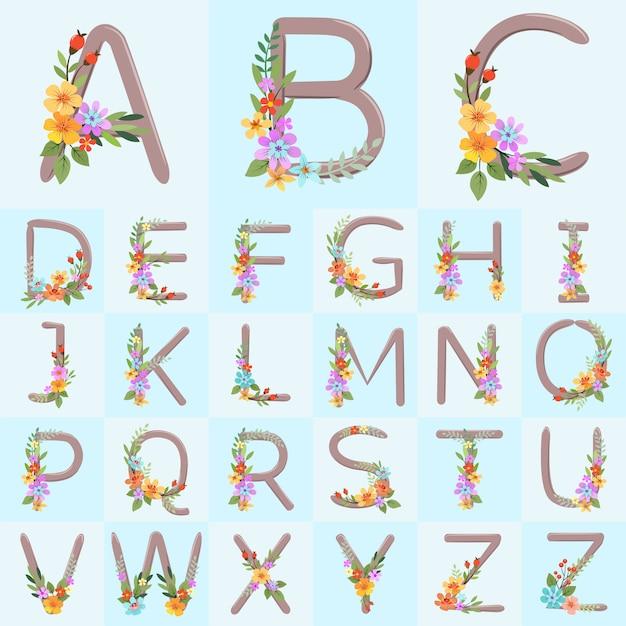Le lettere dell'alfabeto con i fiori rustici disegnati a mano su fondo blu vector la progettazione. Vettore Premium