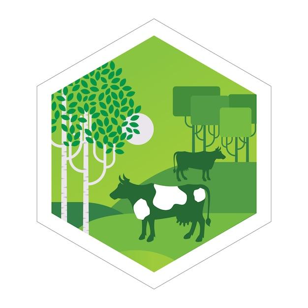 Le mucche pascolano nel prato Vettore Premium