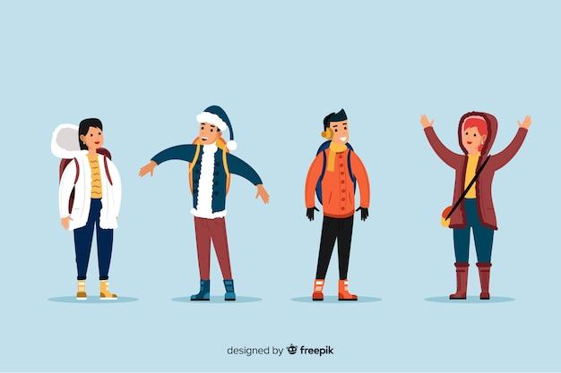Le persone che indossano abiti invernali in varie posizioni Vettore gratuito