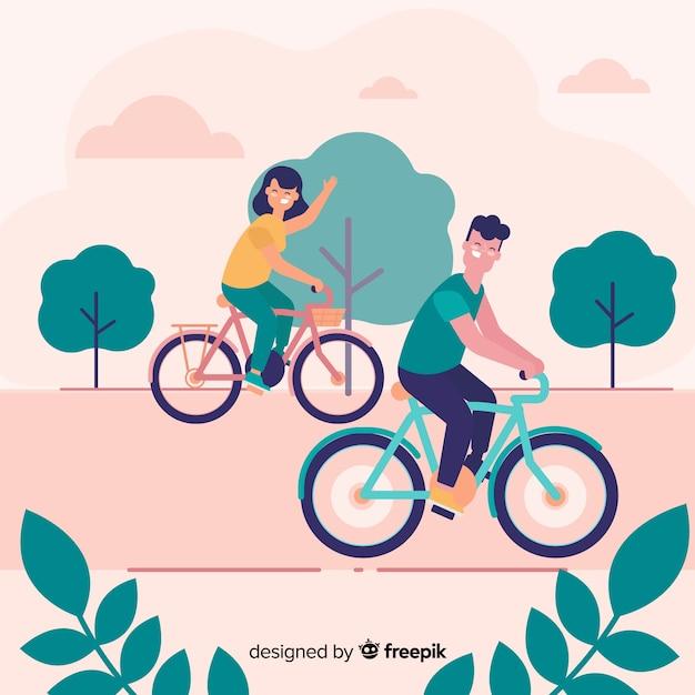 Le persone in sella a una bicicletta nel parco Vettore gratuito