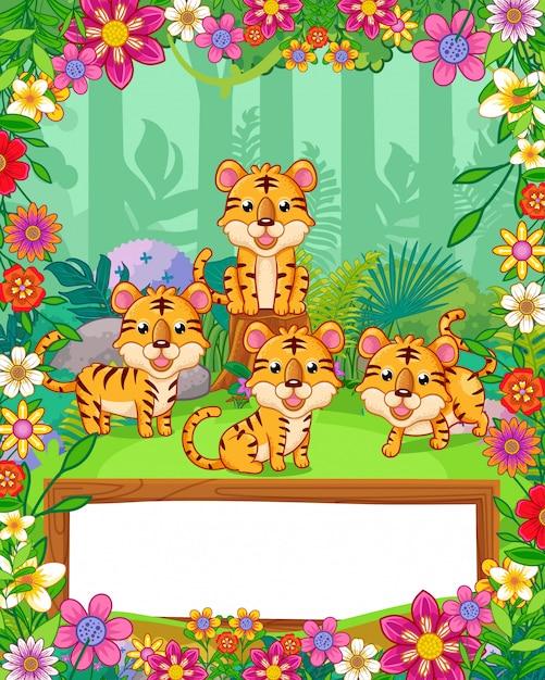 Le tigri sveglie con i fiori e lo spazio in bianco di legno firmano dentro la foresta. vettore Vettore Premium