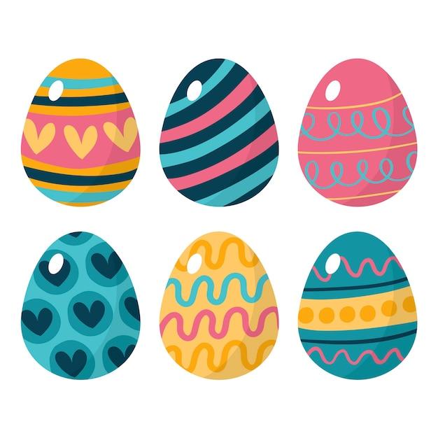 Le uova di giorno di pasqua felici disegnate a mano con i cuori progettano Vettore gratuito