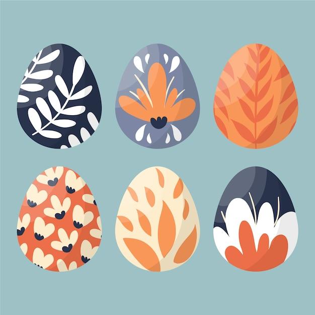 Le uova di giorno di pasqua felici disegnate a mano con la natura hanno dipinto la progettazione Vettore gratuito