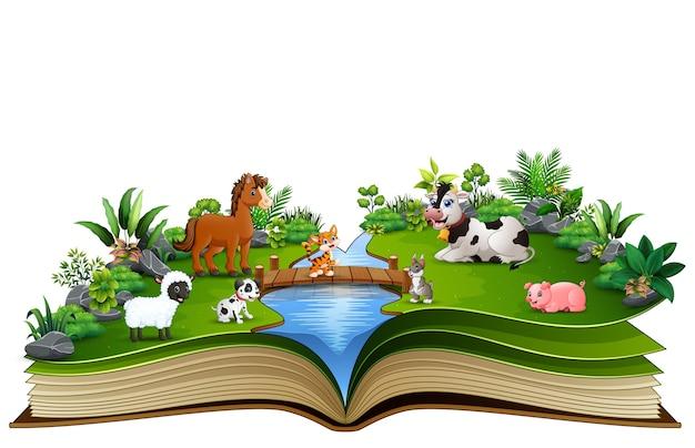 Libro aperto con fattoria degli animali nel parco Vettore Premium