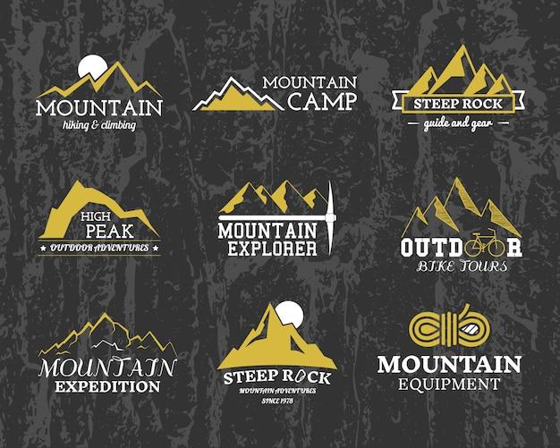 Loghi di esploratori di montagna, collezione di modelli di distintivi di campo. viaggi, escursioni, arrampicata. all'aperto. Vettore Premium