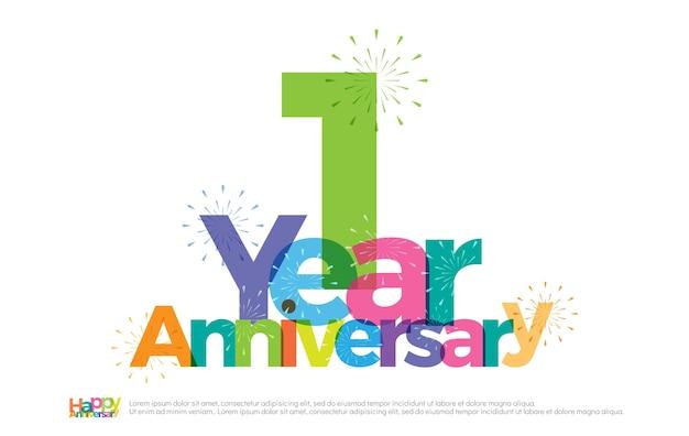 Logo colorato di 1 anno anniversario celebrazione con fuochi d'artificio Vettore Premium
