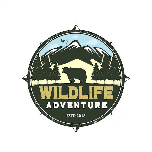 Logo dell'avventura della fauna selvatica Vettore Premium