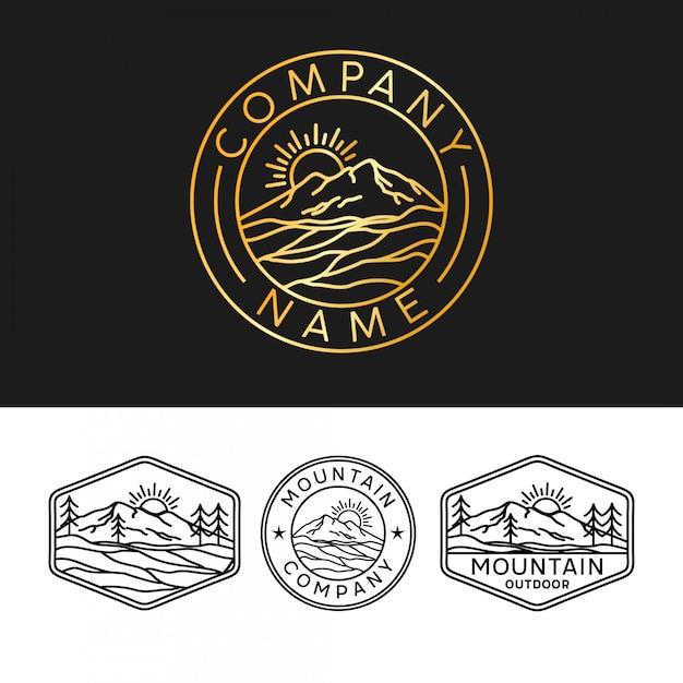 Logo della montagna con lo stile del contorno Vettore Premium