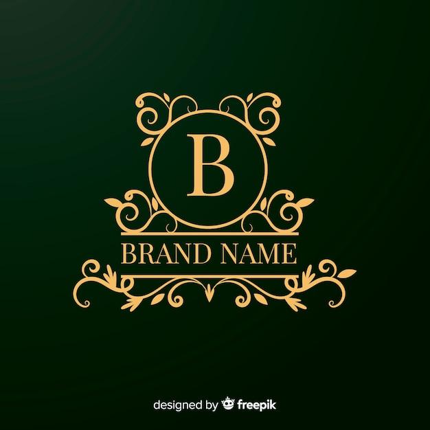 Logo design ornamentale dorato per aziende Vettore gratuito
