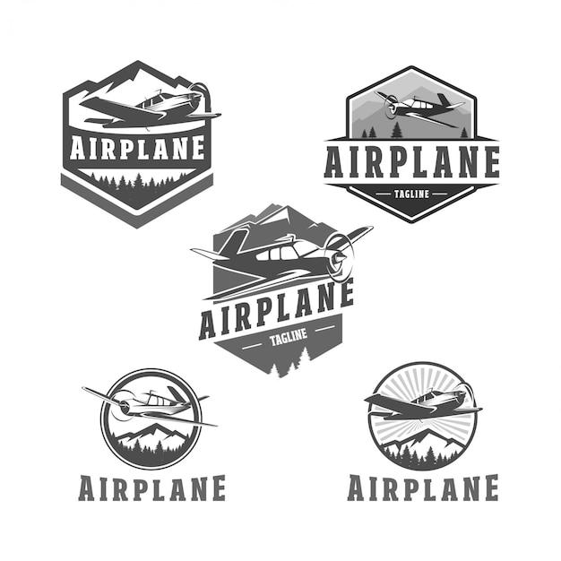 Logo distintivo dell'aeroplano Vettore Premium