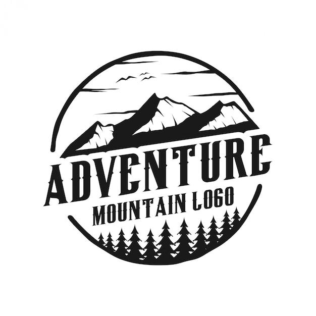 Logo vintage con esterno con elementi di montagna Vettore Premium